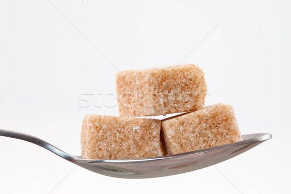 Spoon with  brown sugar against white background Stock photo © wavebreak_media