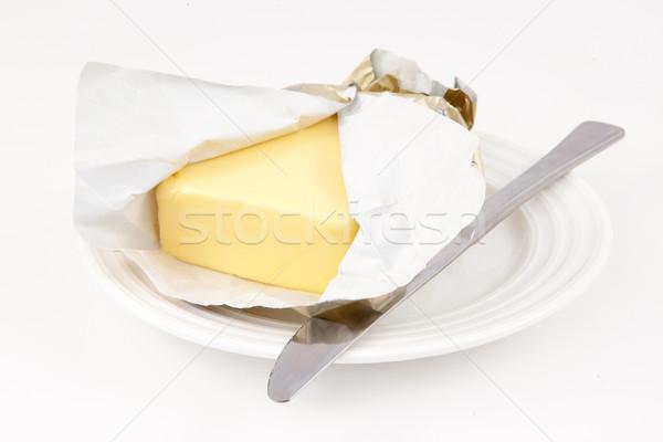 Tereyağı fincan tabağı beyaz arka plan bıçak Stok fotoğraf © wavebreak_media
