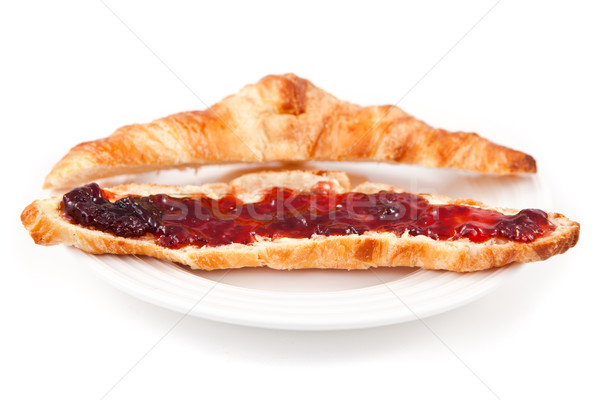 Croissant spread with jam in a plateful against white background Stock photo © wavebreak_media