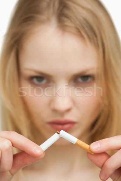 серьезный женщину сигарету белый курение Сток-фото © wavebreak_media