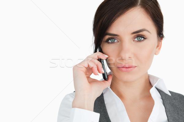 Blue eyed businesswoman on the phone against white background Stock photo © wavebreak_media