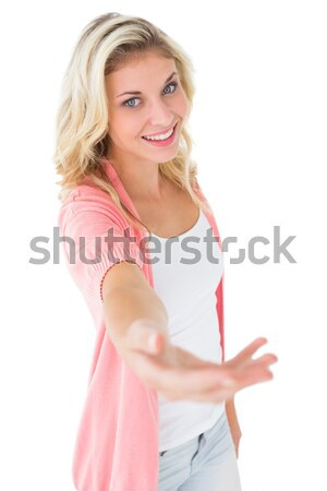 Smiling blonde crossing her arms while standing against a white background Stock photo © wavebreak_media
