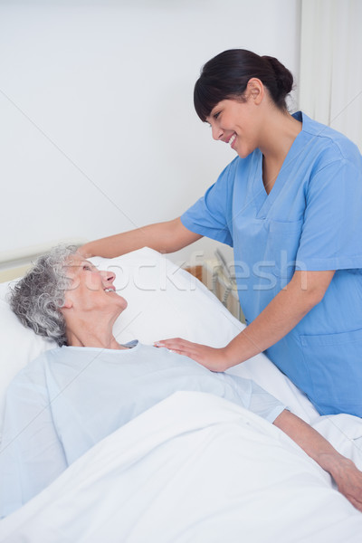 Nurse touching the shoulder of a patient in hospital ward Stock photo © wavebreak_media