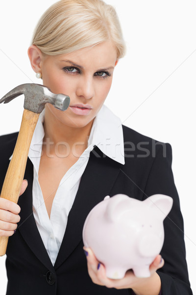 Belle femme d'affaires marteau tirelire blanche Photo stock © wavebreak_media
