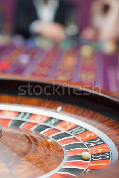 Rueda de la ruleta movimiento casino hombre pelota jugar Foto stock © wavebreak_media