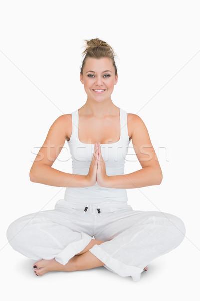 Stock photo: Girl sitting cross-legged smiling in yoga pose