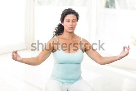 Sesión loto posición blanco mujer Foto stock © wavebreak_media