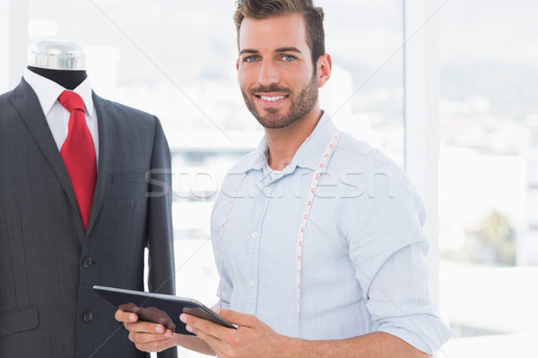 Male fashion designer with digital tablet by suit on dummy Stock photo © wavebreak_media