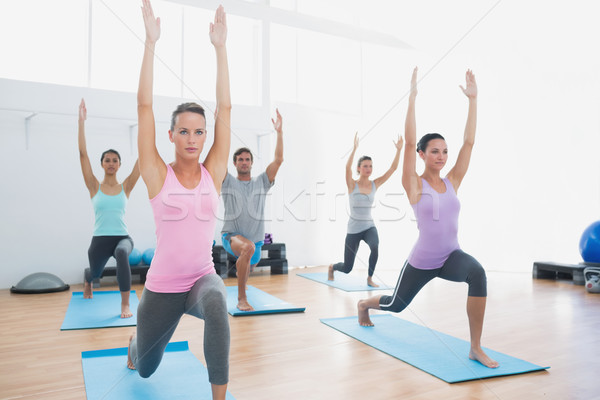 Class doing pilate exercises in fitness studio Stock photo © wavebreak_media