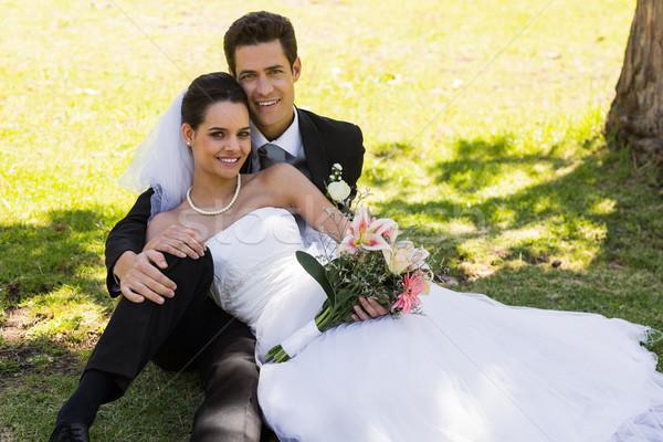 Boldog friss házas pár ül park portré Stock fotó © wavebreak_media