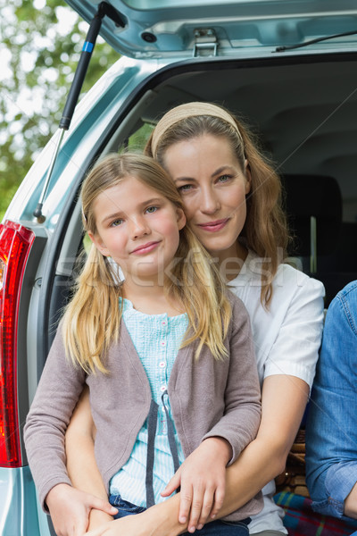 Smiling mother and daughter sitting in car trunk Stock photo © wavebreak_media