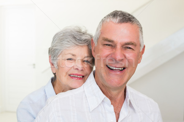 Retired couple smiling at camera Stock photo © wavebreak_media