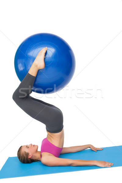 Side view of a fit woman exercising with fitness ball Stock photo © wavebreak_media