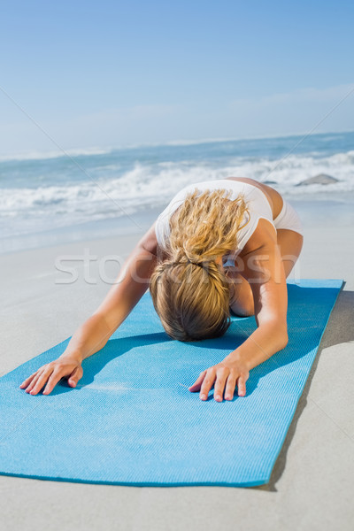 Gorgeous fit blonde in childs pose on the beach Stock photo © wavebreak_media