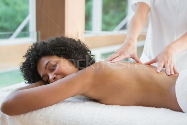 Gorgeous woman enjoying a back massage Stock photo © wavebreak_media