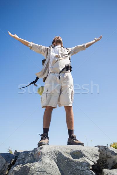 Handsome hiker standing at the summit Stock photo © wavebreak_media