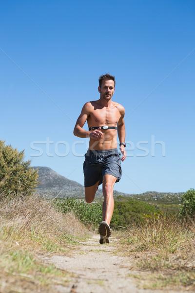 Gömleksiz adam jogging kalp hızı izlemek etrafında Stok fotoğraf © wavebreak_media