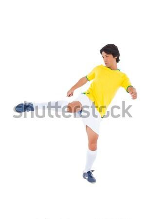 Giallo calci bianco uomo sport Foto d'archivio © wavebreak_media