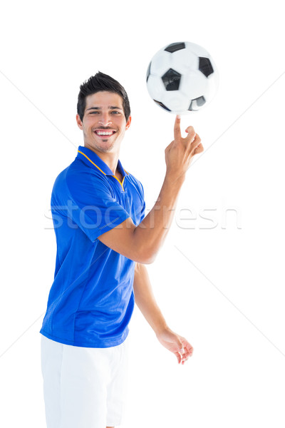 Football player in blue spinning ball Stock photo © wavebreak_media
