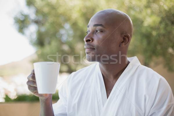красивый мужчина халат кофе за пределами дома Сток-фото © wavebreak_media