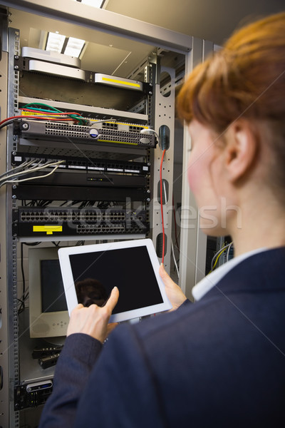 Pretty technician using tablet pc while fixing server Stock photo © wavebreak_media