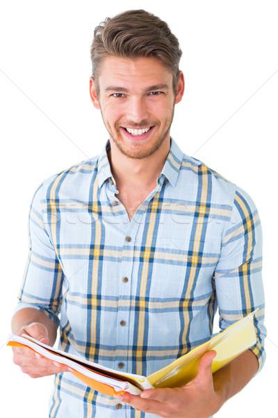 Jóképű diák olvas jegyzettömb fehér portré Stock fotó © wavebreak_media