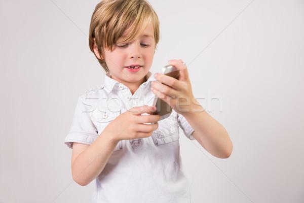 Student using a mobile phone Stock photo © wavebreak_media