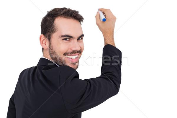 Feliz empresario escrito marcador blanco traje Foto stock © wavebreak_media
