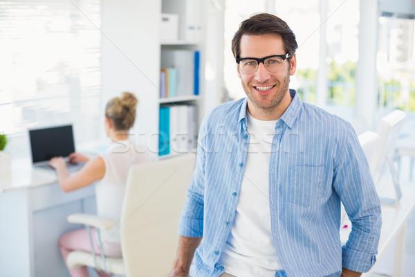 Portré mosolyog fotó szerkesztő visel olvasószemüveg Stock fotó © wavebreak_media