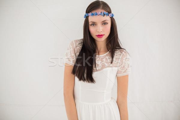 Bastante hippie olhando câmera cinza parede Foto stock © wavebreak_media