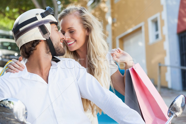 Stock photo: Cute couple riding a scooter