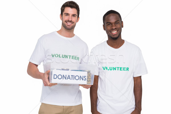 Stock photo: Portrait of smiling men participating at charity