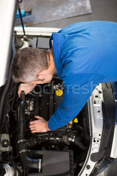 Mechanic examining under hood of car Stock photo © wavebreak_media