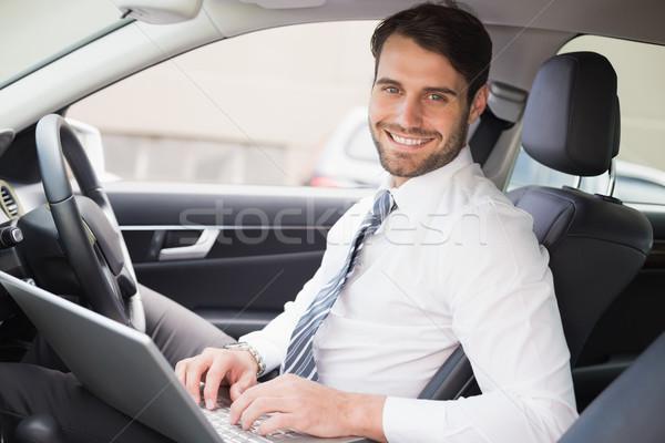Empresário trabalhando assento carro negócio computador Foto stock © wavebreak_media