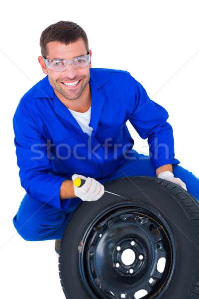 портрет счастливым механиком рабочих шин белый Сток-фото © wavebreak_media