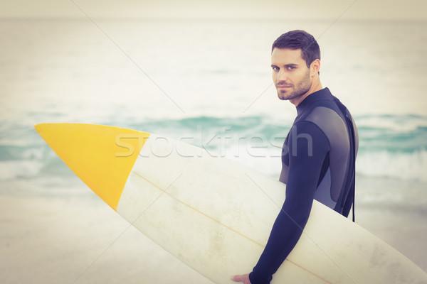 Homem prancha de surfe praia feliz esportes Foto stock © wavebreak_media