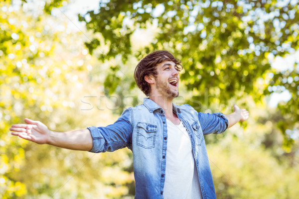 Stock photo: handsome hipster feeling free in the park