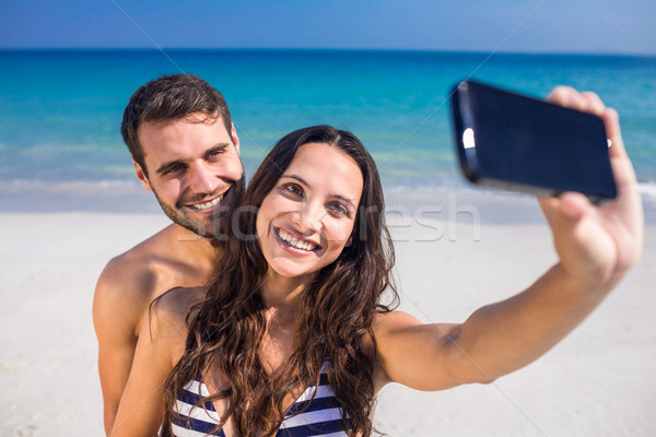 Happy couple taking a selfie at the beach Stock photo © wavebreak_media