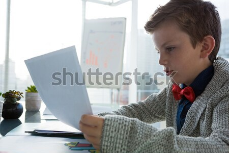 Casual businesswoman resting head on desk Stock photo © wavebreak_media
