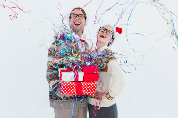 Excited geeky hipster couple looking at confetti Stock photo © wavebreak_media