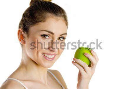 Slim woman holding green apple Stock photo © wavebreak_media