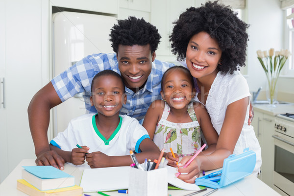 Stock photo: Happy parents helping children with homework