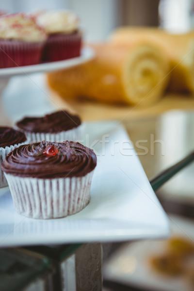 Muffinok pékség napos idő fa szék bútor Stock fotó © wavebreak_media