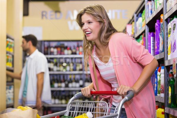 Gülen sarışın kadın satın alma ürünleri süpermarket adam Stok fotoğraf © wavebreak_media