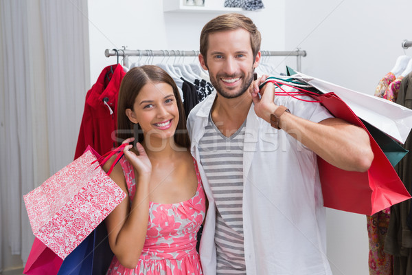 Portré mosolyog pár bevásárlótáskák butik férfi Stock fotó © wavebreak_media