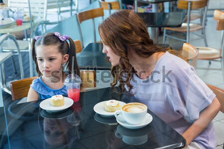 Smiling sibling having breakfast cereal in kitchen Stock photo © wavebreak_media