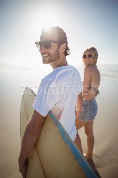 Stock fotó: Boldog · fiatal · pér · kéz · a · kézben · tengerpart · napos · idő · nő