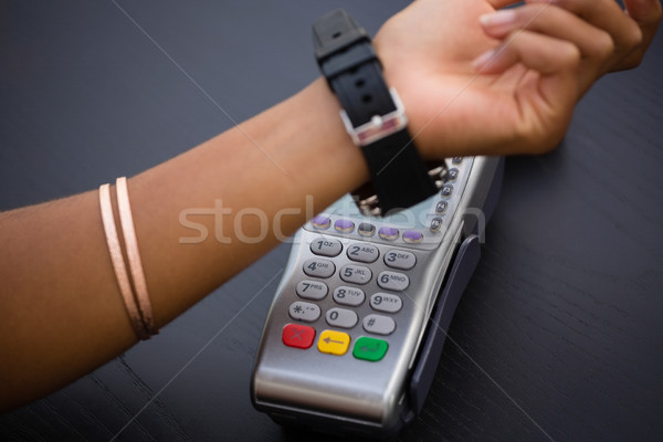 Hand of woman making payment via smart watch Stock photo © wavebreak_media