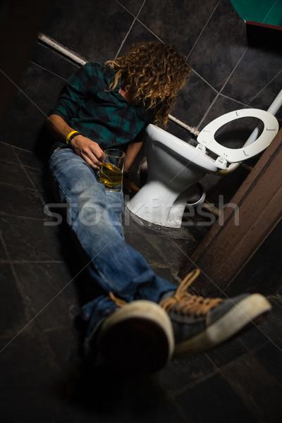 Man sleeping in the washroom Stock photo © wavebreak_media