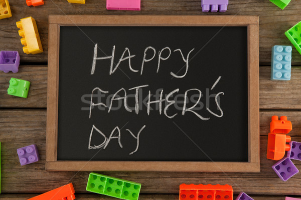 Slate with happy fathers day text amidst toy blocks on table Stock photo © wavebreak_media